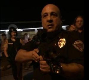 Ferguson Cop points gun at journalists on 8-20-14