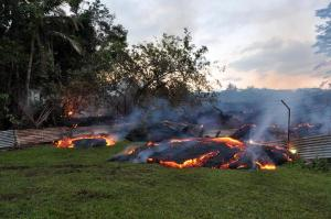 By dawn on Tuesday morning, lava had crossed into two privately owned properties above Pāhoa