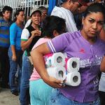 Venezuelan Woman Earns Her Living Standing in Line to Buy Toilet Paper